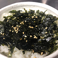 Japan-grown rice topped with dried seaweed and barbecue tare sauce